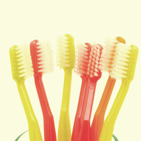 toothbrushes in old vintage retro style photo