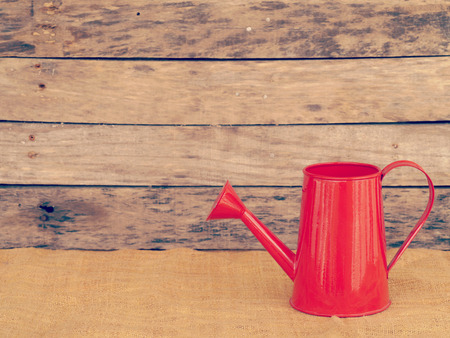 Red watering can retro vintage style photo