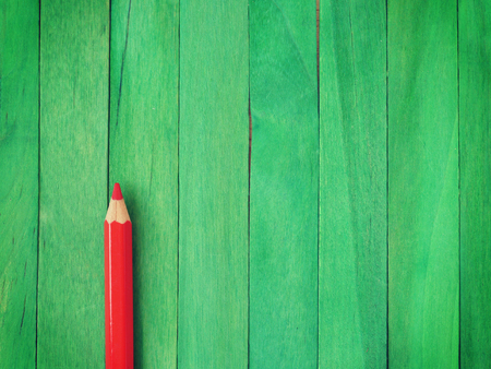 Red Pencil on Green Background old retro vintage style photo