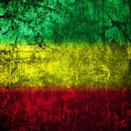 rastafari: Red, yellow, green rasta flag on Concrete wall Stock Photo