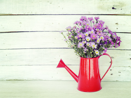 flowers and watering can old retro vintage style photo