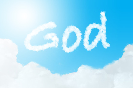 God text in clouds form with blue sky background photo