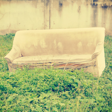 Old broken sofa with retro filter effect