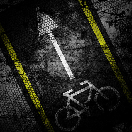 Bicycle road sign grunge background textured on concrete wall photo