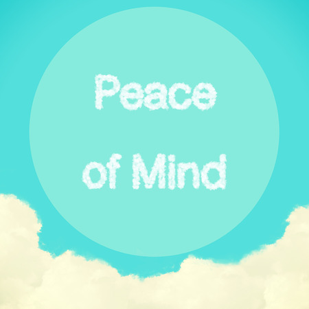 stres: Peace of Mind message created from clouds on blue sky with retro filter effect Stock Photo