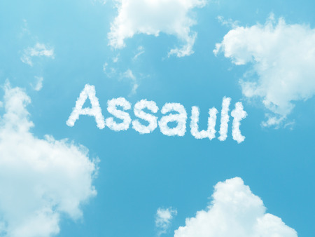 Assault cloud word with design on blue sky background photo
