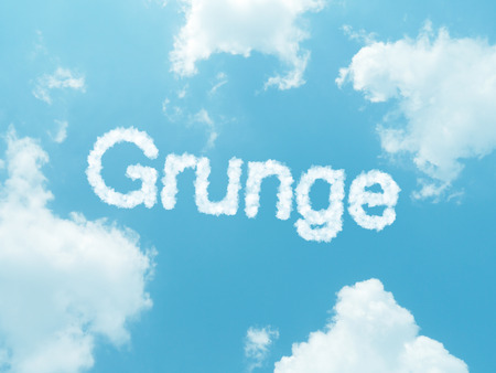grunge cloud word with design on blue sky background photo