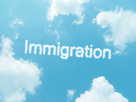 schengen: immigration cloud word with design on blue sky background Stock Photo