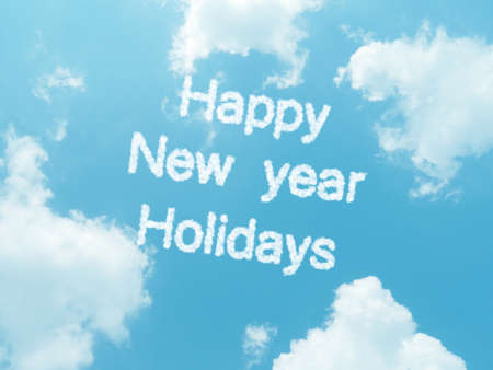 happy new year holidays cloud words with design on blue sky background photo