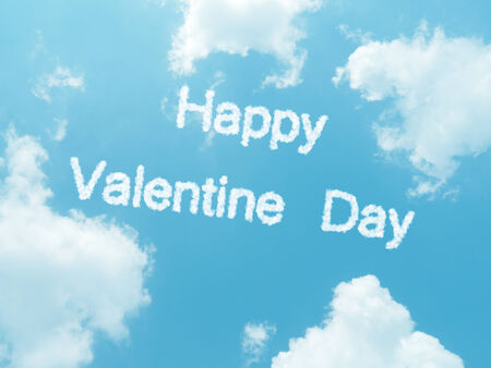 happy valentine day cloud words with design on blue sky background photo