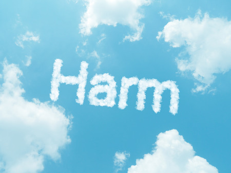 harm: harm cloud word with design on blue sky background