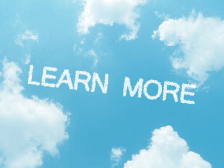 learn more cloud words with design on blue sky background photo