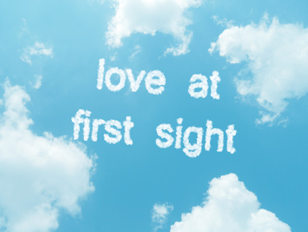first sight: Love at first sight cloud words with design on blue sky background Stock Photo