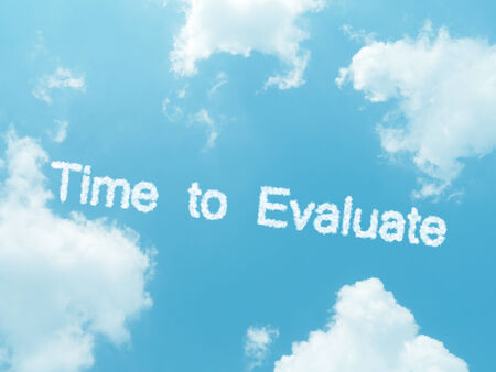 reevaluation: cloud words with design on blue sky background