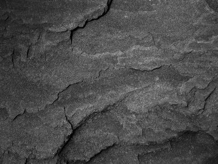 黑色的牆石背景