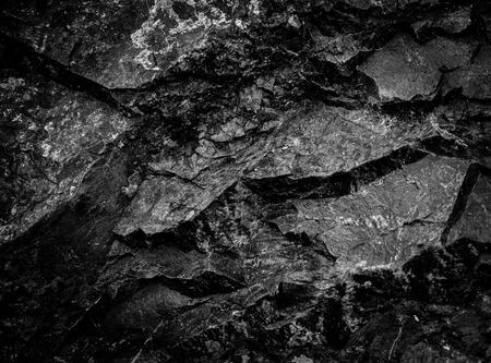Noir mur de pierre de fond