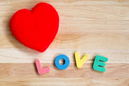 Valentines Day background red heart on wooden background photo