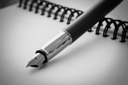 black and white pen on table