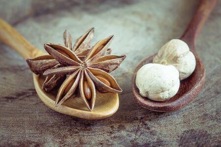 anise: star anise on  wood background Stock Photo