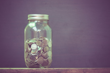 money in the glass with filter effect retro vintage style Stock Photo - 39819290