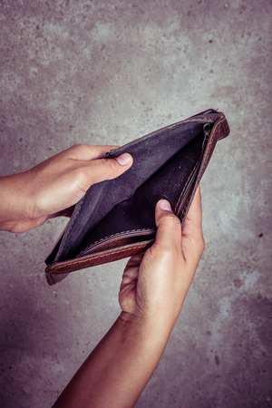 penniless: An empty wallet with filter effect retro vintage style