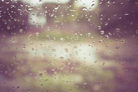 Drops of rain on glass with filter effect retro vintage style 写真素材
