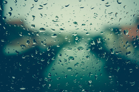rain water: Drops of rain on glass with filter effect retro vintage style Stock Photo