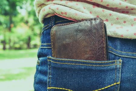 resourcefulness: wallet in back pocket  with filter effect retro vintage style