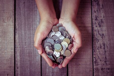 Hands holding money  with filter effect retro vintage style 写真素材