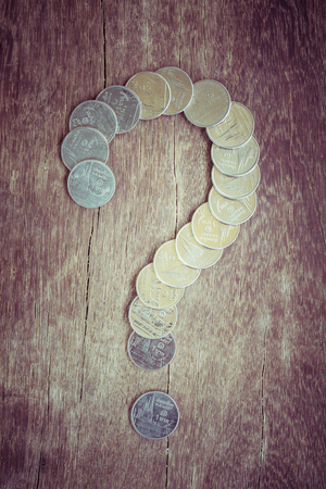 financial questions: Coins baht thailand Question Mark with filter effect retro vintage style