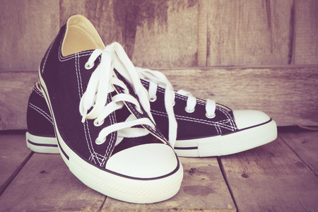 tearing down: black sneakers with filter effect retro vintage style