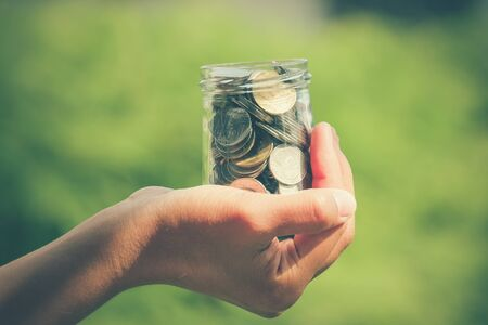 budget crisis: Hands holding money with filter effect retro vintage style Stock Photo