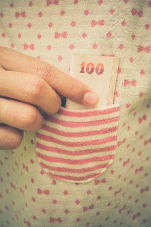 putting money in pocket: Taking money from  pocket with filter effect retro vintage style Stock Photo