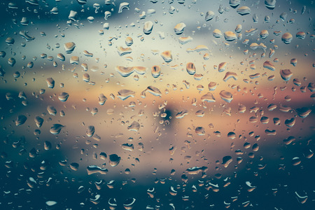 autumn rain: Drops of rain on glass with filter effect retro vintage style Stock Photo