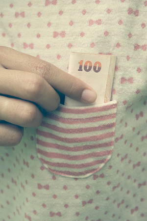hidden success: Taking money from  pocket with filter effect retro vintage style Stock Photo