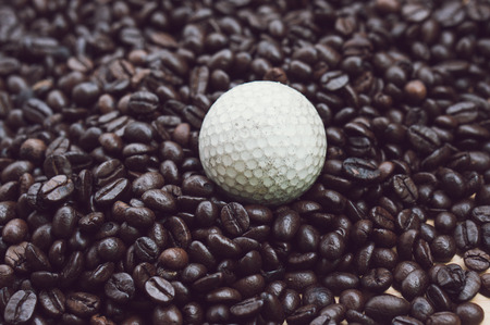 coffee beans and a old golfball with filter effect retro vintage style