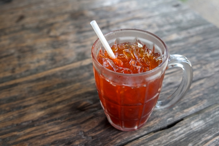 quenching: ice tea on brown wooden table Stock Photo