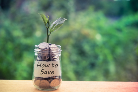 save money for investment concept money in the glass with filter effect retro vintage style