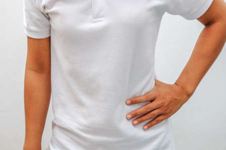 suffering: woman suffering from back pain Stock Photo