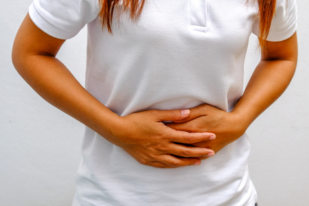 incontinence: Woman Suffering From Stomach Ache