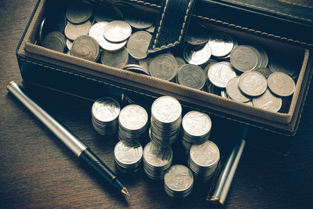 money concept coins and pen with filter effect retro vintage style Stock Photo