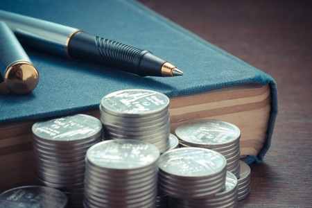 sty: money concept coins and pen with filter effect retro vintage sty
