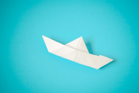 paper boat: paper boat on blue background
