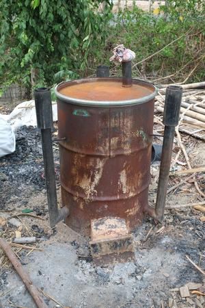garden waste: Garden incinerator bin burning waste from the garden. Stock Photo