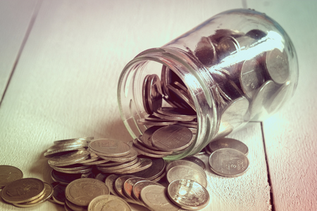 cuenta bancaria: save money for investment concept money in the glass with filter effect retro vintage style