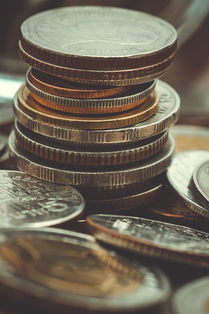 business finance. save money for investment concept coins with filter effect retro vintage style Stock Photo