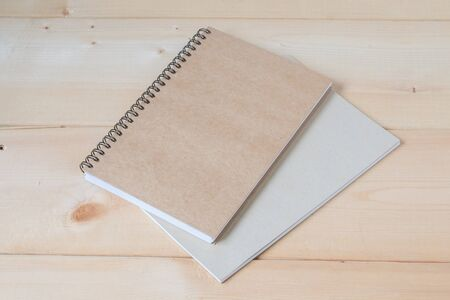 school notebook: recycle notebook on wood background