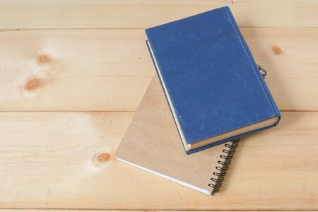 fill up: recycle notebook on wood background