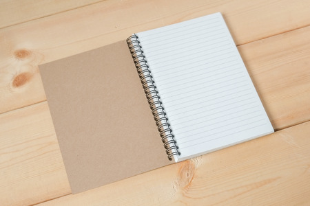 fill in: recycle notebook on wood background