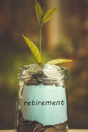 save money for investment concept plant growing out of coins with filter effect retro vintage style